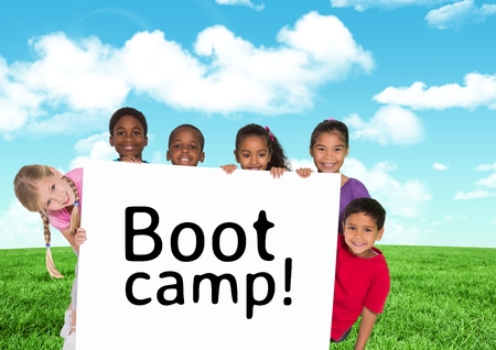 Digital composition of kids holding card showing text  boot camp in front of blue sky and grass