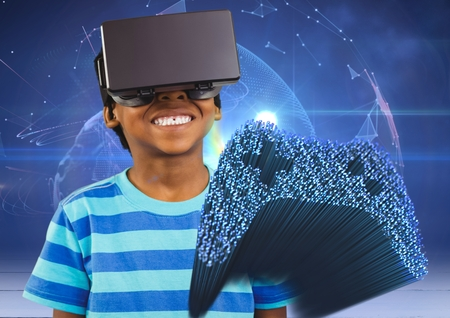 Digital composition of cheerful boy using virtual reality headset and fibre optics interface