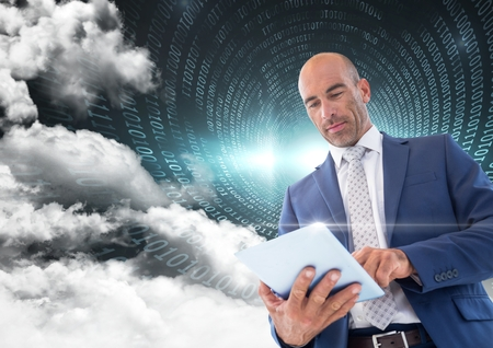 Digital composition of businessman using digital tablet with binary codes and cloud in background