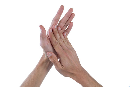 Close up of hands with palms rubbing together against white background