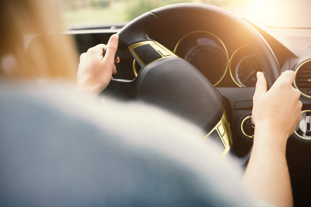 Cropped image of woman driving while travelling in car