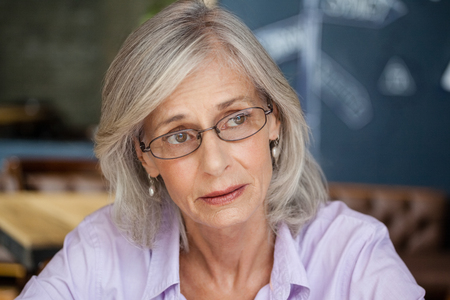 Close up of worried senior woman looking away