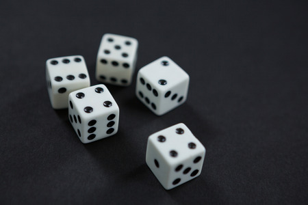 Close-up of white dices on black background