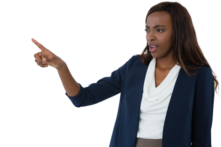 Businesswoman pointing while giving presentation against white background