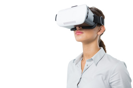 Photo pour Female executive using virtual reality headset against white background - image libre de droit