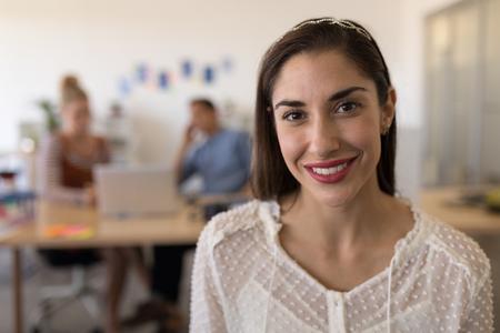 Photo pour Portrait of beautiful happy Caucasian female executive smiling in modern office - image libre de droit