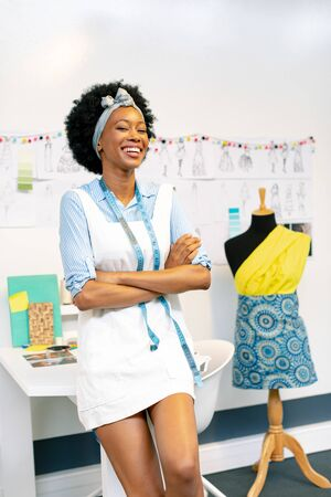 Front View Of Happy African American Female Fashion Designer With Arms Crossed Looking At Camera In Office Royalty Free Images Photos And Pictures