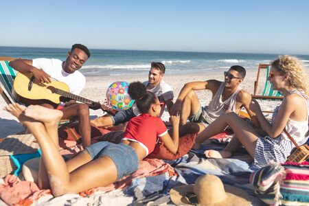 Photo for Front view of group of happy diverse friends having fun together on the beach - Royalty Free Image