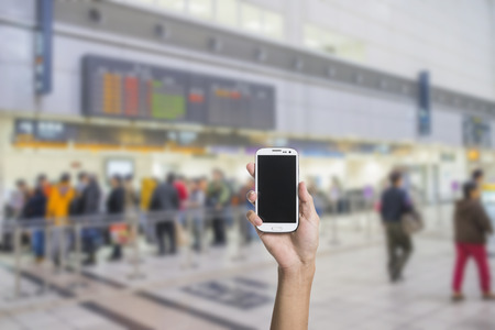 Using smartphone in a subway, closeup image.