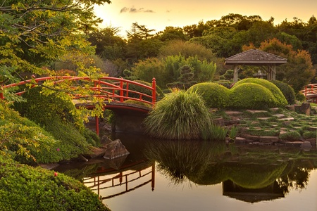 Tranquil Japaneese garden on dusk with reflections in the water