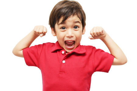 Little boy showing his muscles on white background