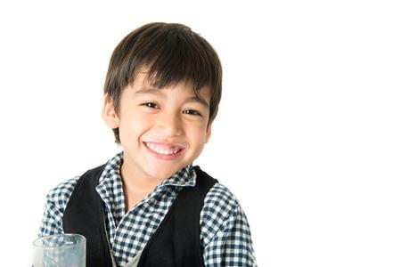 Photo pour Little boy drinking milk on white background; - image libre de droit
