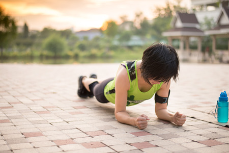 Asian woman work out planking in the park