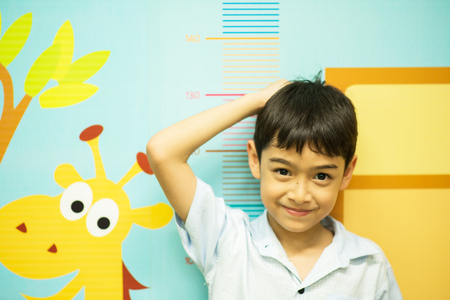 Photo for Little boy checking his height at hospital - Royalty Free Image