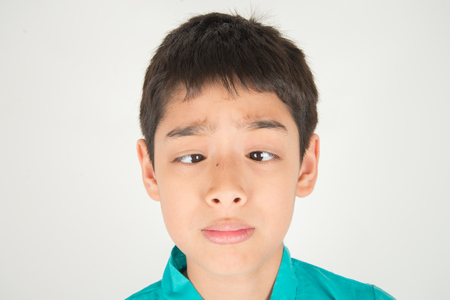 Foto de Little boy making eyes strabismus - Imagen libre de derechos