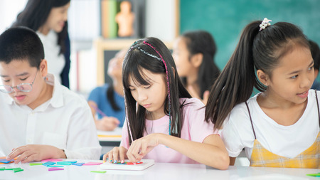 Photo for Group of Students study math with teacher in the classroom - Royalty Free Image
