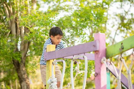 Foto de Little boy playing in the playground outdoor - Imagen libre de derechos
