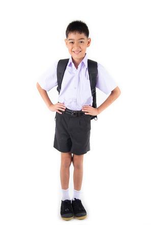 Foto de Little Asain boy in student uniform on white background - Imagen libre de derechos