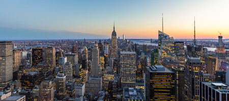 Photo pour Panoramic photo of New York City Skyline in Manhattan downtown with Empire State Building and skyscrapers at night USA - image libre de droit