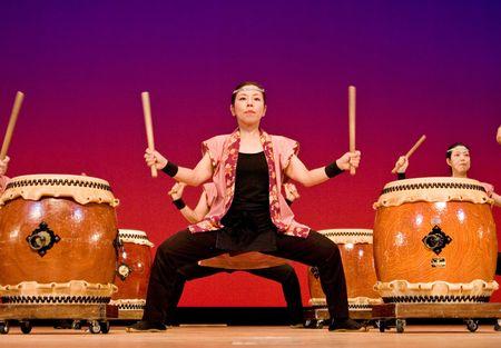 Kagoshima City, Japan, October 27, 2007.  Japanese women performing taiko drumming onstage at Taniyama Furusato Matsuri festival.