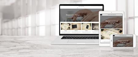 Foto de Banner of multi device technology for responsive web design - laptop , digital tablet and smartphone in various orientation at the office (sample web page). - Imagen libre de derechos