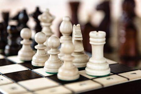 Photo pour Close up of chessboard with classic wooden pieces with selective focus - image libre de droit