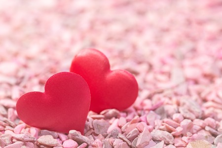 Foto de Two hearts on pink stones. Concept of love for Valentines Day - Imagen libre de derechos