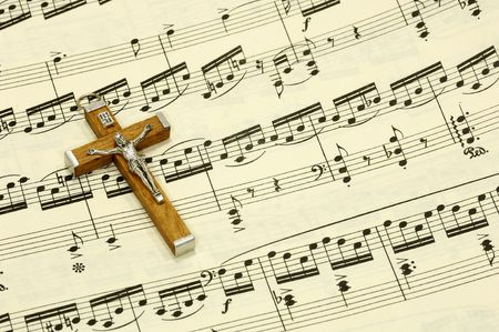 Crucifix on top of Sheet Music