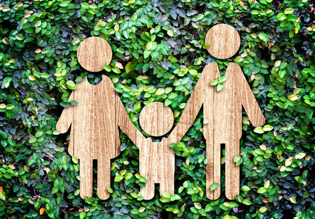 Family wood icon on green leaf wall,Eco concept