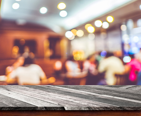 Photo for Empty wood table top with restaurant blur with bokeh background,Product display template - Royalty Free Image