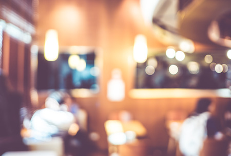Blurred background : Vintage filter Customer in Coffee shop blur background with bokeh.