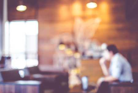 Photo pour Blurred background : Vintage filter Customer in Coffee shop blur background with bokeh. - image libre de droit
