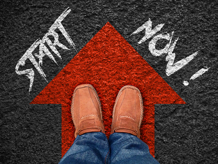 Inspiration quote :  Start now on aerial view of shoe on road with move forward blue arrow ,Motivational typographic.