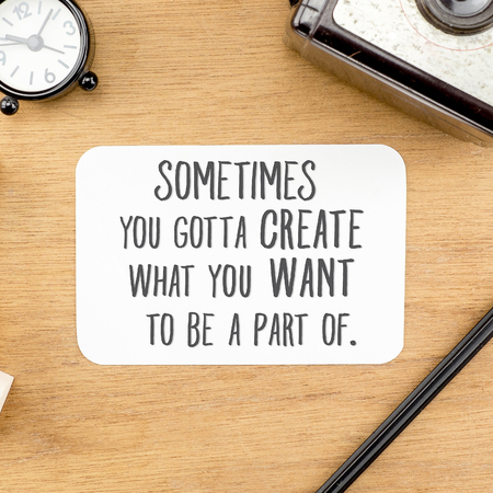 Photo pour Inspiration quote :  Sometime you gotta create what you want to be a part of word on paper at wooden table with clock,camera,pencil  ,Motivational typographic. - image libre de droit