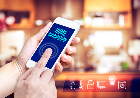 Photo pour Hand holding smart phone with home control application with blur home background, Smart home concept. - image libre de droit
