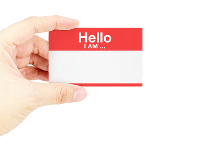 Hand holding business card with Hello I am ... with white background.