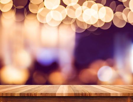 Foto de Empty perspective wood plank table top with abstract bokeh light background,Mock up for montage of your product. - Imagen libre de derechos