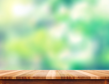 Photo for Empty plank brown wood table top with blur green tree background, Template mock up for montage of product. - Royalty Free Image