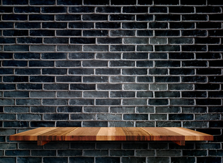 Empty wooden shelfs on black brick wall, Mock up template for display of product.
