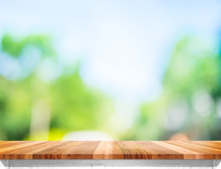 Photo pour Empty brown wood table top with sun and blur green tree bokeh background, Template mock up for montage of product. - image libre de droit