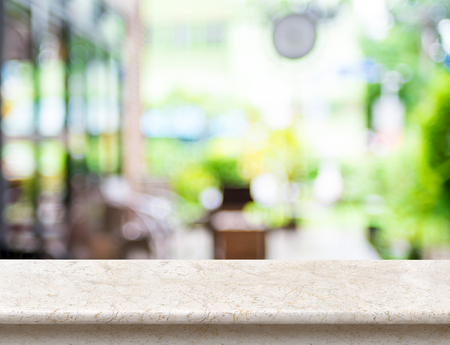 Foto de Empty luxury white marble table top with blurred cafe bokeh light as background. Mock up for display or montage of product,Business presentation. - Imagen libre de derechos