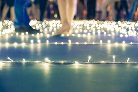 Foto de Blurred background,low angle view of people walk at night event fair with bokeh light. - Imagen libre de derechos