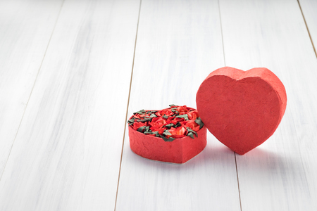 Heart shape box with red roses inside on white wood table top ,Love concept,Valentine\'s day card,Copy space for display of content.