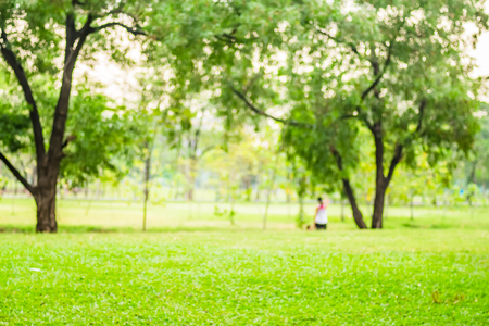 Blurred background,People exercise at green park with bokeh light. Healthy lifestyle concept.