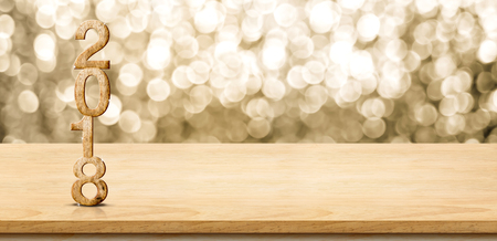 Photo pour 2018 new year wood number on wood table with sparkling gold bokeh wall,panoramic banner for display or montage of product. - image libre de droit