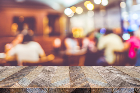 Empty old plank wooden table top with blurred crowd of people dinner in restaurant ,Mock up template for display or montage of your design,Banner for advertise of product