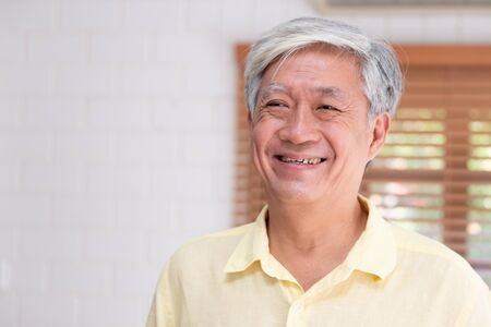 Photo pour Asian senior man smile in living room at home,Happy aging at home concept. - image libre de droit