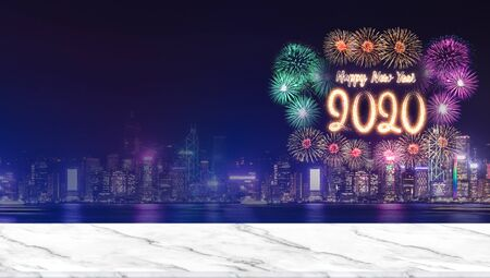 Photo for Happy new year 2020 fireworks over cityscape at night with empty marble table top,Panoramic banner mock up template for display or montage of product for holiday promotion advertising - Royalty Free Image