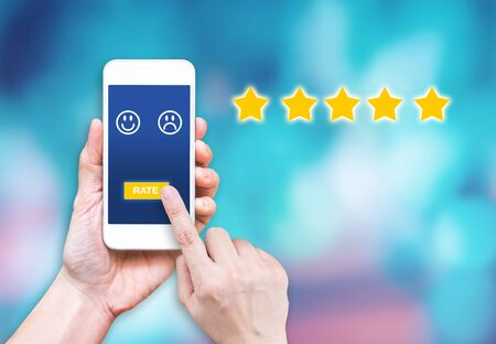 Photo pour hand click rating on mobile to give satisfaction of service online.customer review experience of service - image libre de droit