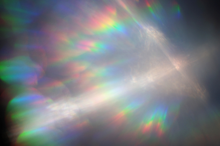 Photo for spectrum of the light in rainbow color and white cross - Royalty Free Image
